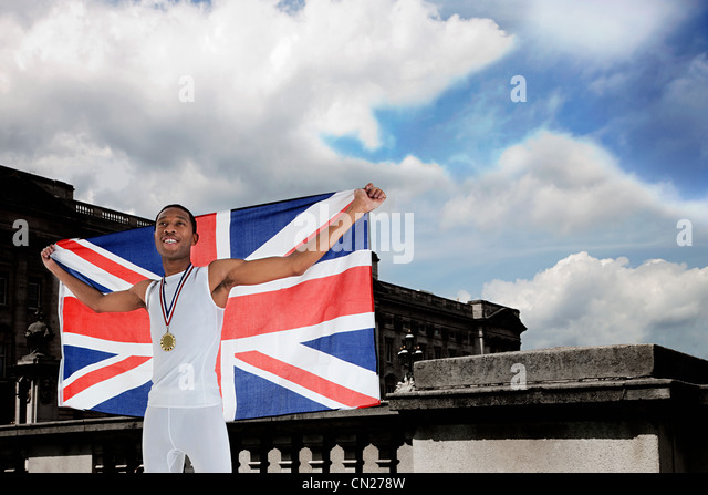 Olympic gold medal winner with Union Jack - Stock Image