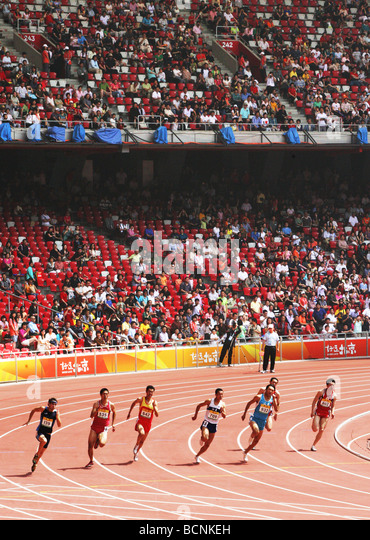 Chinese atheletes competing in 100m run during Good Luck Beijing Game in Bird's Nest, Beijing, China - Stock Image