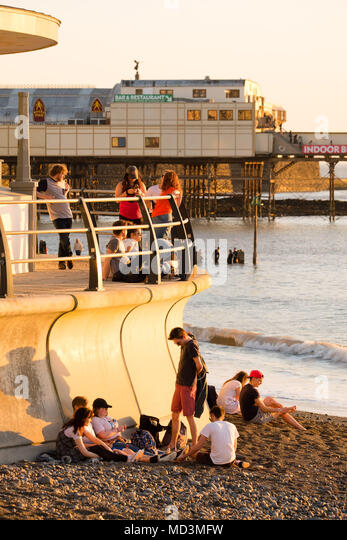 Aberystwyth Wales UK, Wednesday  18 April 2018  People enjoying the sunset  in Aberystwyth  at the end of a day of gloriously warm spring sunshine, as temperatures across the UK start to soar into the high 20's centigrade, making it the warmest April weather for many years.   photo © Keith Morris  / Alamy Live News - Stock Image