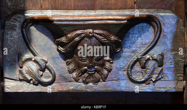 A Medieval caricature of a happy, bearded and whiskered, man in the choir stalls of Hexham Abbey, United Kingdom - Stock Image