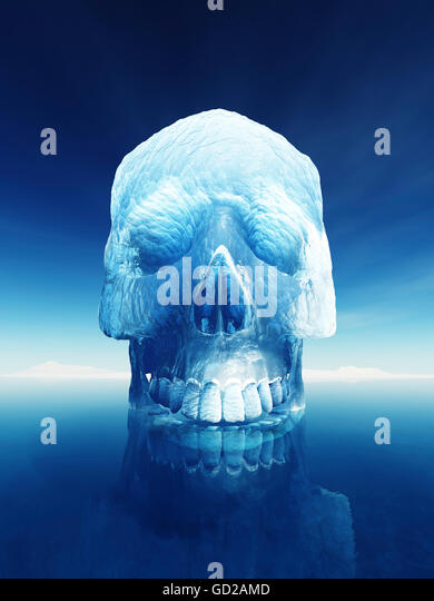 Iceberg in the shape of a human skull. Conceptual image of inherent danger of an iceberg or the arctic meltdown - Stock Image