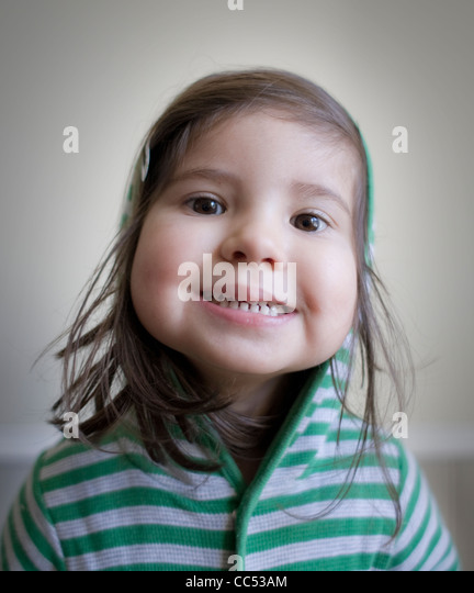 Girl wearing green striped top - Stock Image