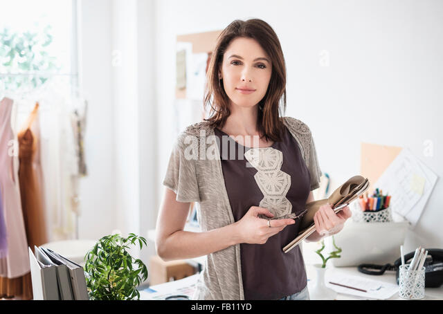 Young woman looking at camera - Stock Image