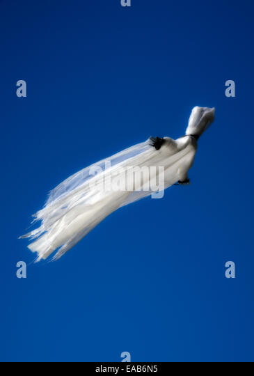 Spirit figure floating in the sky. - Stock Image