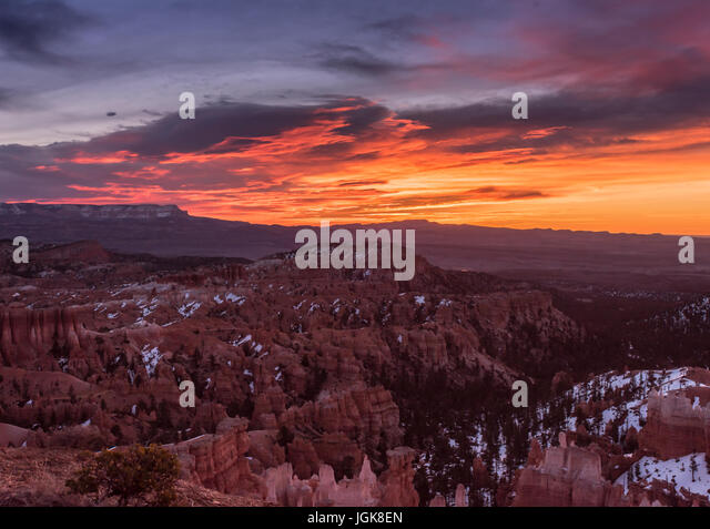 Vibrant Sunrise Over Bryce Canyon Hoodoos with lingering snow - Stock Image