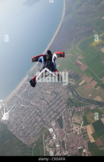 Wingsuit flying over Empuriabrava, Spain - Stock Image