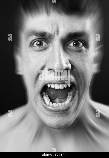 Loud scream of scared frighten young man - Stock Image