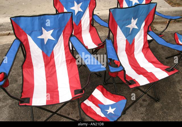 Miami Florida Little Havana Calle Ocho Festival Cuban fair folding chairs Puerto Rico flag theme - Stock Image