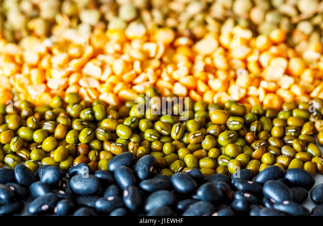 Cereals background: chickpeas, peas, lentils, black beans - Stock Image