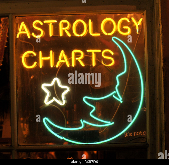 Astrology Charts' neon sign on Bourbon Street, French Quarter, New Orleans, Louisiana - Stock Image