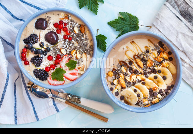 Healthy vegan breakfast: chocolate and berry smoothies bowls. - Stock Image
