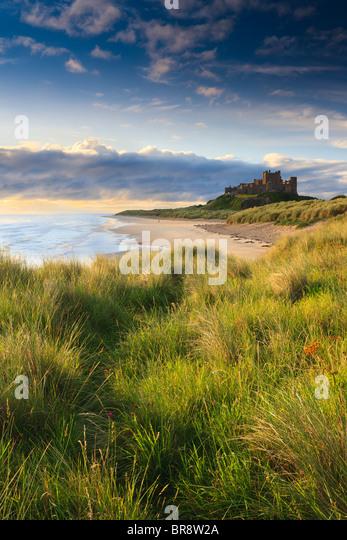 Bamburgh Castle at sunrise on the east cost of Northumberland, England. - Stock Image