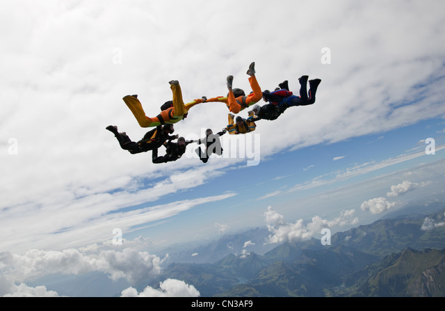 Formation skydivers over Saanen, Switzerland - Stock Image