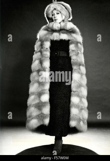 A model wearing a fur coat with hood - Stock Image