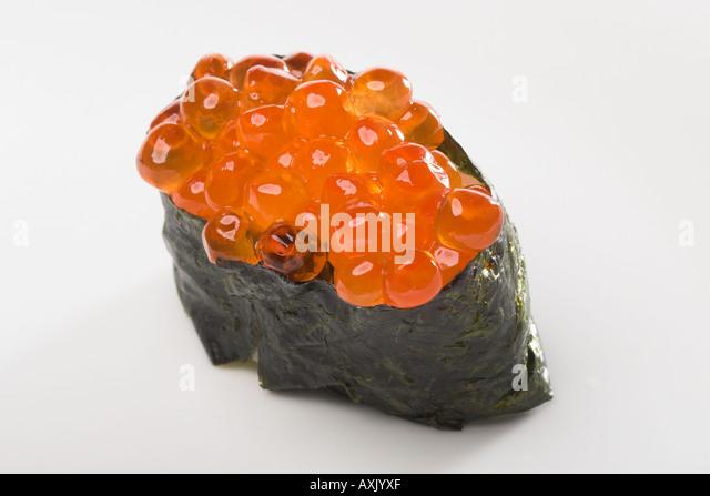 ikura sushi seaweed fish eggs food meal appetizer ethnic Asian cultural green orange fresh plants moist circle shine - Stock Image