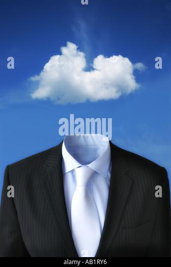a cloud floating above a business suit - Stock-Bilder