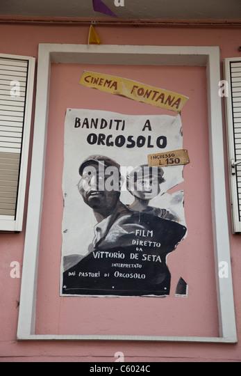 Cinema Poster in Orgosolo village, Nuoro Province, Sardinia, Italy - Stock Image
