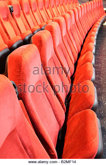 Indiana Portage Portage 16 IMAX movie theater complex red chair seating row empty folding - Stock Image