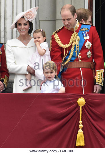 Catherine, Duchess of Cambridge holding Princess Charlotte, Prince George and Prince William, stand on the balcony - Stock Image