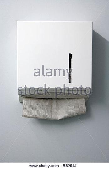 paper towel dispenser in a public bathroom - Stock Image