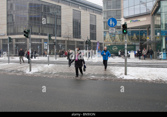 Crossing road at traffic lights, Dresden, Germany. - Stock Image