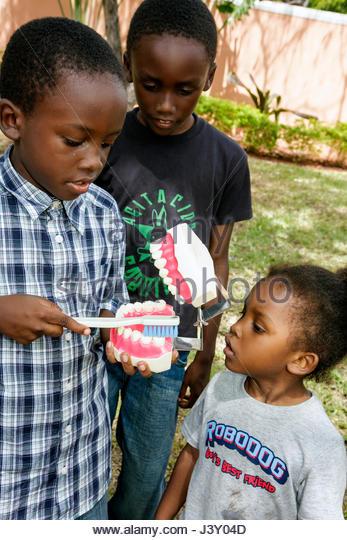Miami Florida Liberty City Jessie Trice Community Health Center free care exam Black boy girl child teeth dental - Stock Image
