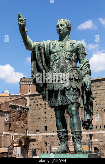 The bronze statue of Emperor Trajan near the ruins of Trajan's Markets and the Roman Forum in the city of Rome in - Stock Image