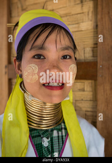 Giraffe woman Inle Myanmar Burma Asia attraction colourful faith lake neck long painful religion touristic tradition - Stock-Bilder