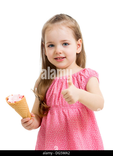 happy kid girl eating ice cream and showing thumb up - Stock Image