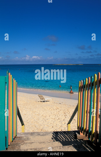 Bahamas Paradise Island Beach with colorful railings leading to the water at Atlantis Resort - Stock Image
