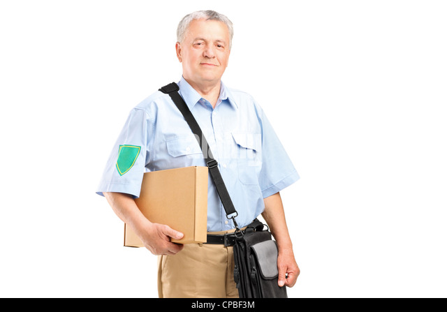A mature postman delivering a box isolated on white background - Stock Image