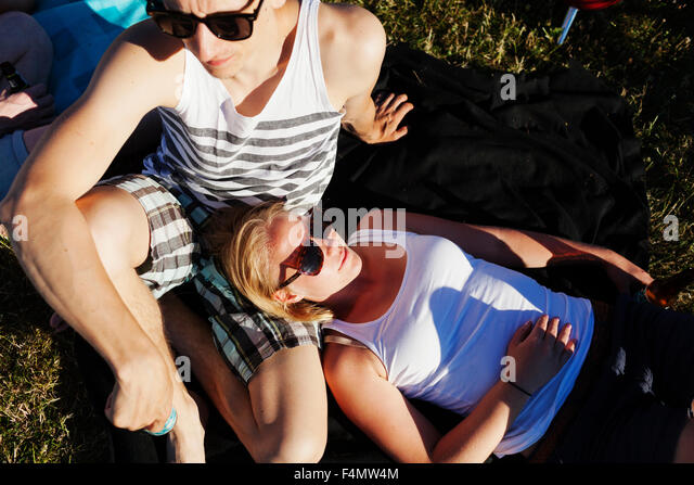 High angle view of woman and man relaxing at picnic - Stock Image