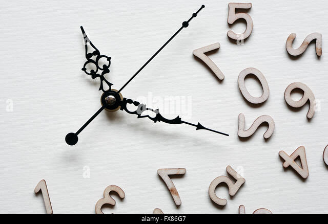 Time concept. Minute and second hands near set of wooden digits - Stock Image
