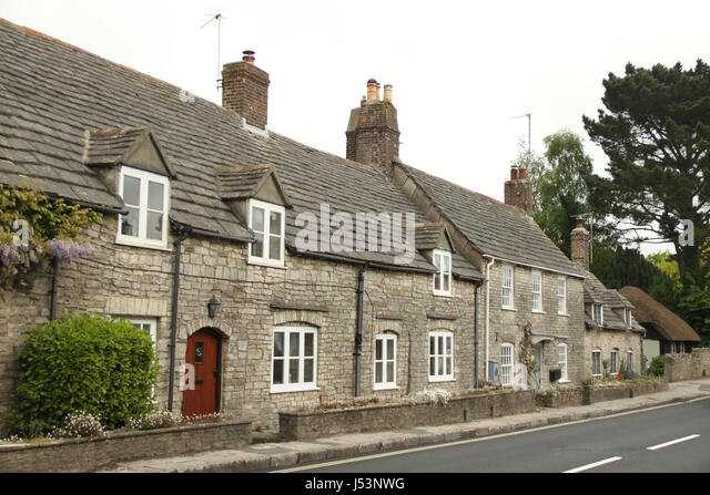Swanage, UK -  12 May: Purbeck stone houses along East Street in the Corfe Castle village on May 12 2017. The village - Stock Image