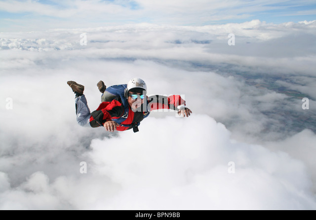 Close-up of skydiver in freefall - Stock Image