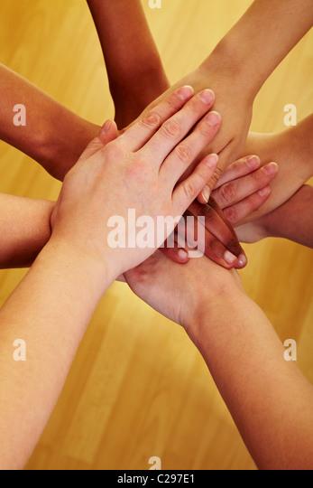 Joined hands - Stock-Bilder