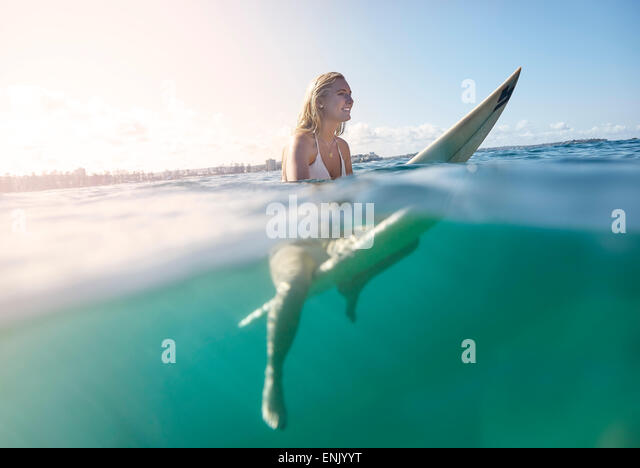 Girl on surfboard, New South Wales, Australia, Pacific - Stock Image