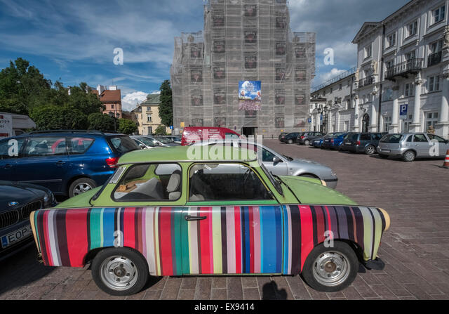 Old Trabant car with multi coloured striped side panel, Warsaw, Poland - Stock Image