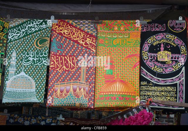 Islamic wall hangings displayed for sale near the Haji Ali Mosque, Mumbai - Stock Image