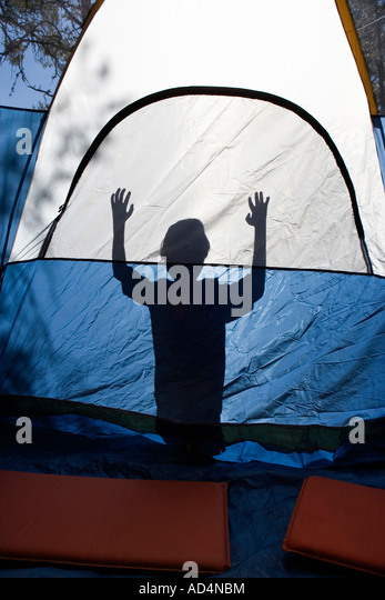 Shadow of a young boy behind a tent - Stock-Bilder