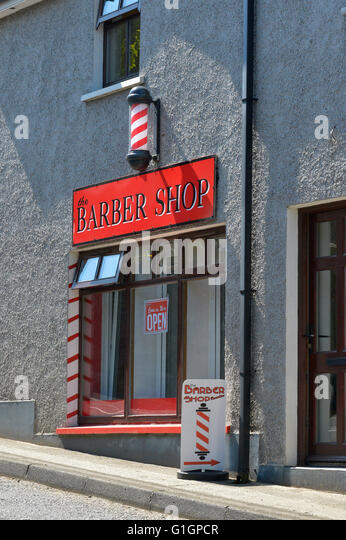 Barbershop with red and white pole in Ramelton, County Donegal, Ireland - Stock Image