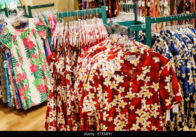 Hawaii Oahu Hawaiian Honolulu Ala Moana Center centre mall shopping sale display retail aloha shirts floral pattern - Stock Image