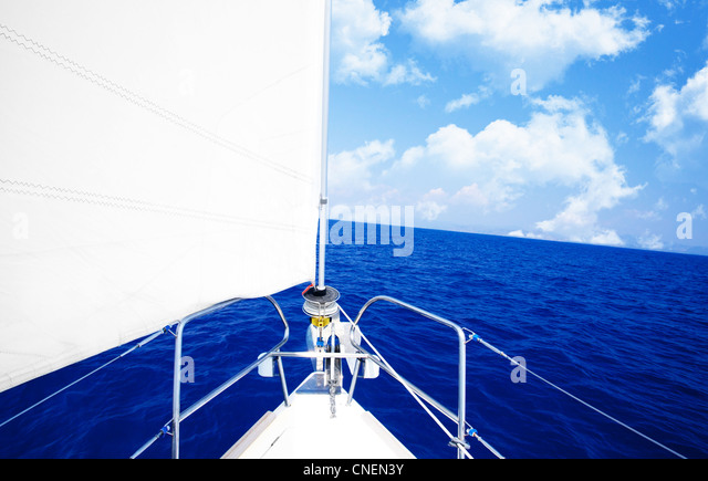 White sailboat at open blue sea, luxury boat parts, extreme sport, freedom concept - Stock Image
