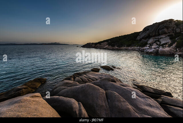First glow of sunrise at dawn over Sardinia, Italy - Stock Image