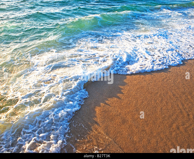 High angle view of ocean waves on shore - Stock Image