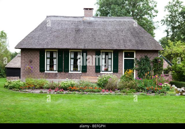 Giethoorn canals holland netherlands stock photos giethoorn canals holland netherlands stock - Small belgian houses brick ...