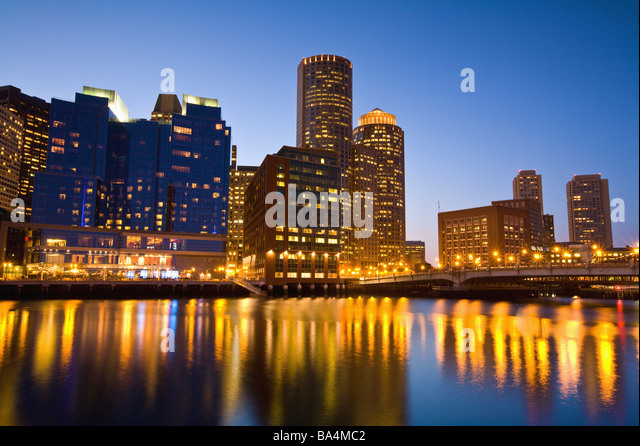 Boston Harbor skyline and waterfront at dusk, financial district - Stock Image