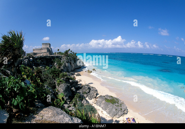 Mexico Tulum Maya Ruins The Castle popular tourist attraction near Playa Del Carmen beside the blue green caribbean - Stock Image