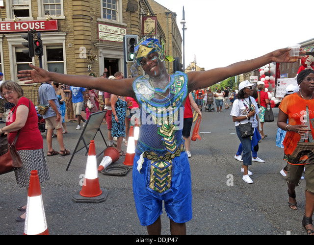 Costumed dancer in blue from Huddersfield Carnival 2013 African Caribbean parade street party - Stock Image