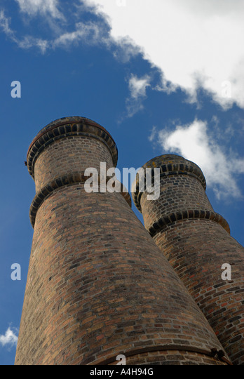 Twin chimneys stock photos twin chimneys stock images for Twin chimneys